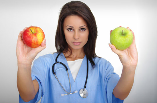 female-doctor-holding-two-apples-smaller