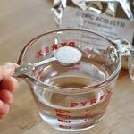 Measure out 1 cup of water. Stir in the citric acid until dissolved.